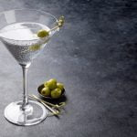 Vodka martini cocktail, vermouth and olives